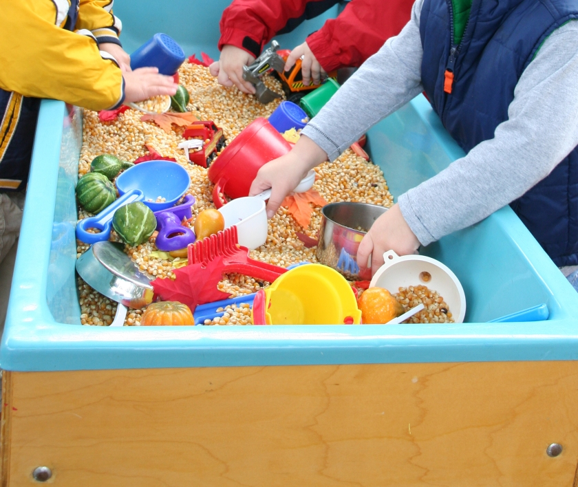 Kids playing in a sensory sandbox