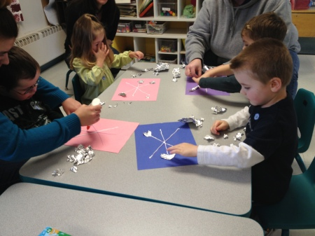 Students working on a snowflake art project